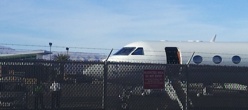 "A private jet arrives at Palm Springs Airport the morning of the ""Defending Free Enterprise"" Koch meeting."
